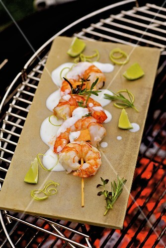 Barbecued prawn skewers with melon and lime yoghurt