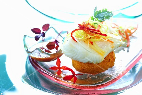 Steamed snowfish on sticky rice cake and fish sauce