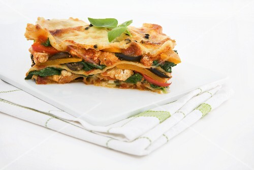 Vegetable lasagne on chopping board