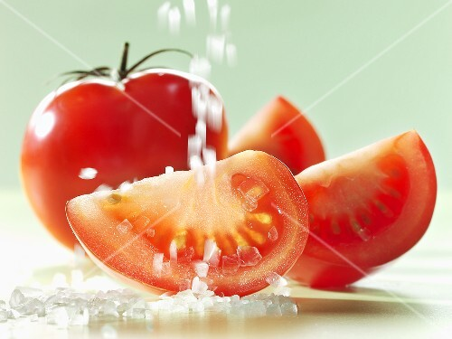 Sprinkling tomatoes with salt