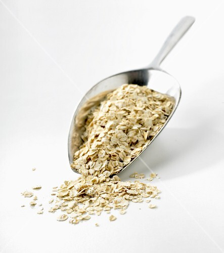 Rolled oats on metal scoop