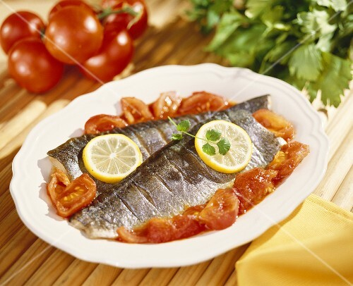 Steamed trout with tomatoes