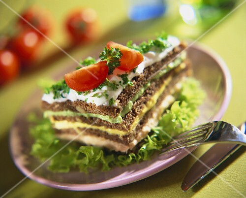 Wholegrain bread layered with fish, curry & avocado spread