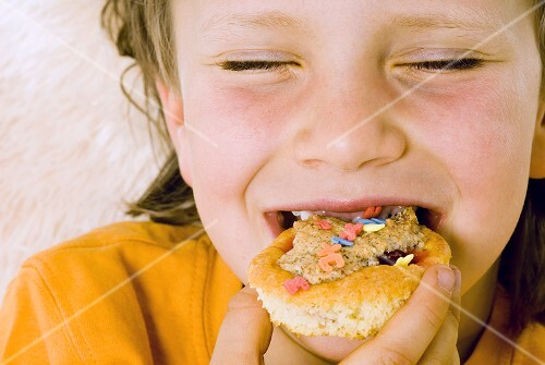 Boy biting into a muffin