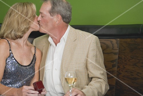 Mature couple kissing in a restaurant