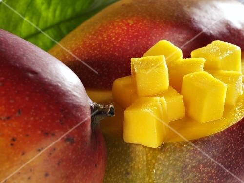Diced mango on whole mangos