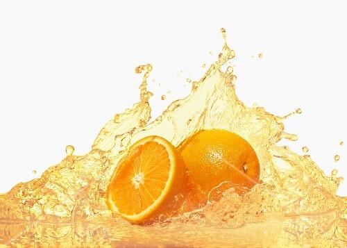 Oranges with splashing orange juice