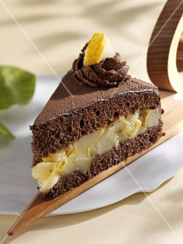A piece of chocolate cake with pear filling