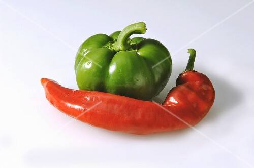 A green pepper and a red chili pepper