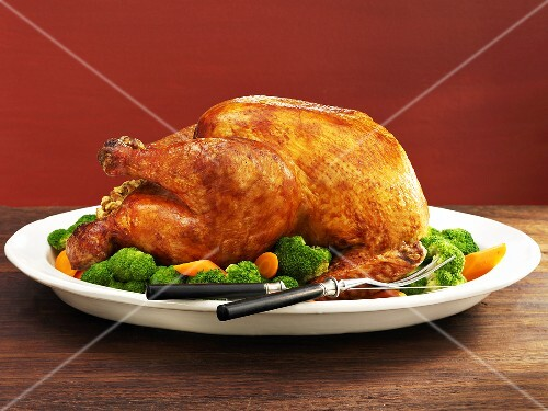 Roasted stuffed turkey with vegetables