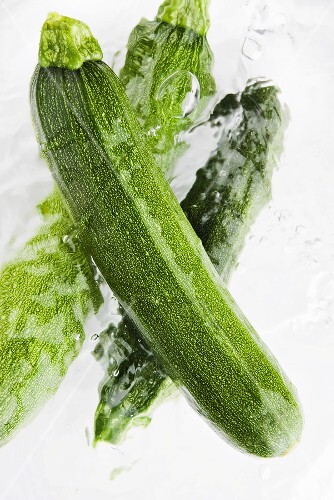 Three courgettes in water