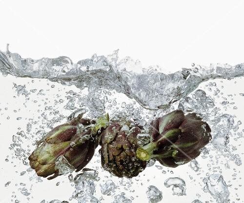 Artichokes in boiling water