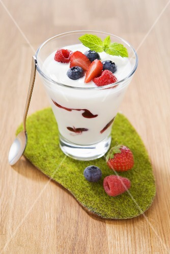 Yogurt with various berries in a glass