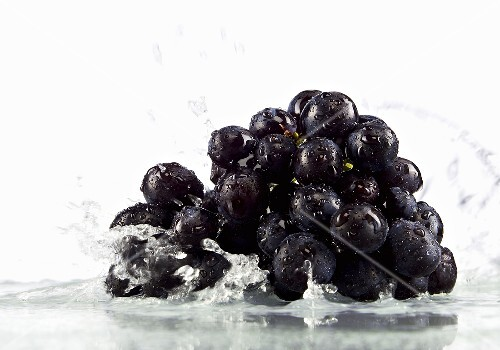 Red grapes in water