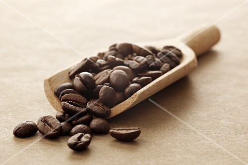 Coffee beans on a wooden scoop