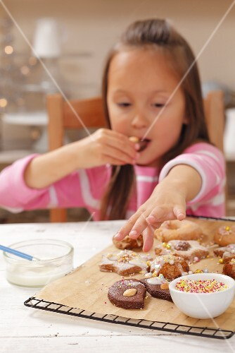 A girl eating freshly baked Christmas biscuits