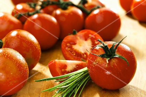 Freshly washed tomatoes and fresh chives