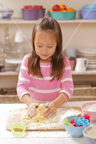 A girl kneading shortbread