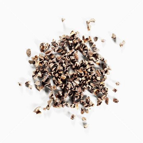 Cocoa nibs on a white surface