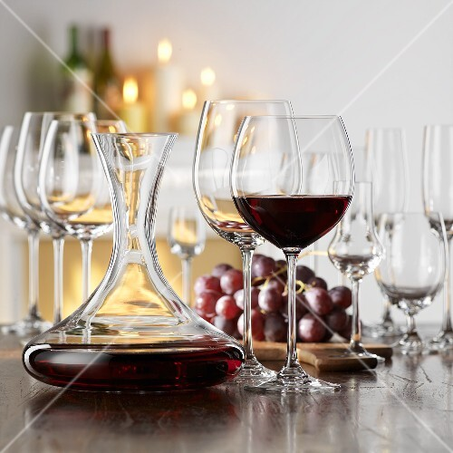 Still life with red wine in glass and decanter
