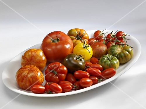 Various types of tomatoes on a platter