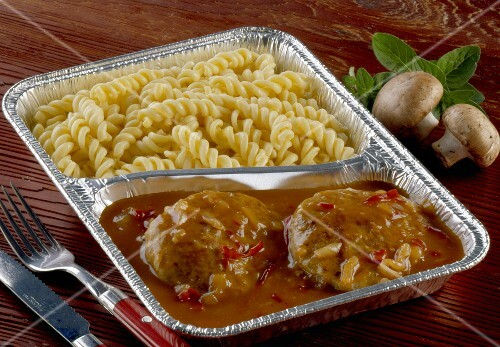 Burgers with gypsy sauce and pasta in aluminium dish