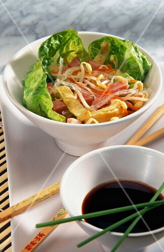 A salad of cellophane noodles, omelette and ham