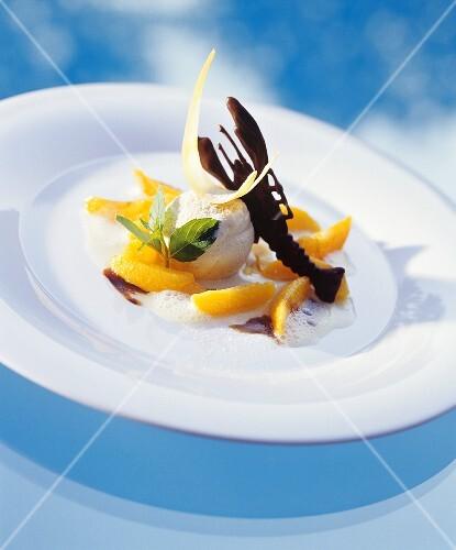 Cinnamon ice cream with nectarine slices and vanilla foam