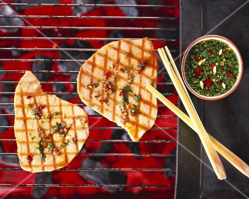 Tuna on a barbecue with coriander and chilli dip