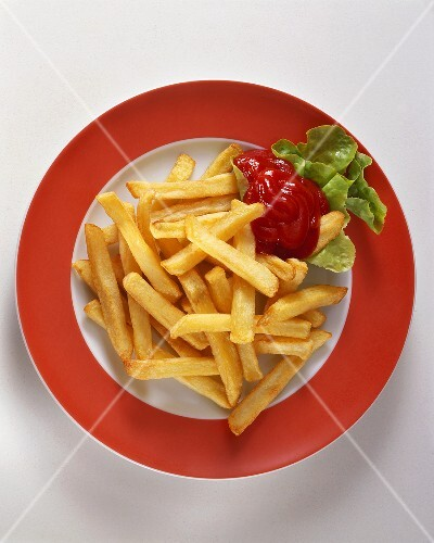 A plate of chips with ketchup