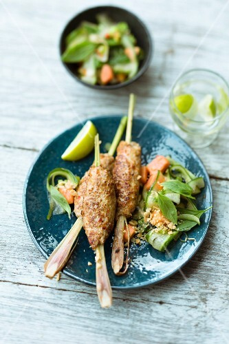 Barbecued Balinese skewers with a cucumber and papaya salad