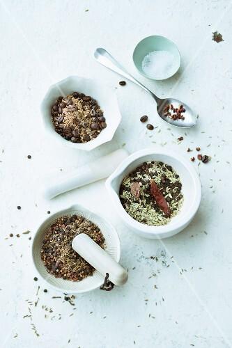 Coffee beans, anise seeds, cardamom, fennel, cinnamon flowers and cloves