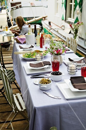 A summery table laid on a jetty