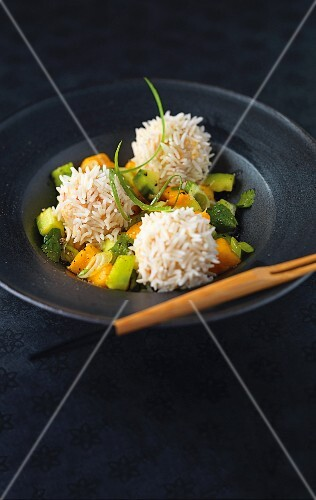 Prawn balls wrapped in rice with a mango and cucumber salad