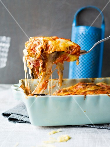 Lasagnea in a baking dish and on a spatula