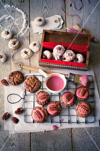 Almond biscuits and pecan nut biscuits with pink icing sugar