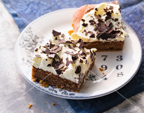 Slices of nougat tray bake cake topped with cream