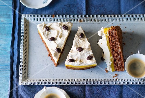 Orange and banana cake with cream and chocolate beans