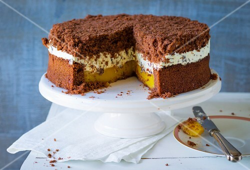 Sliced gingerbread and orange cake on a cake stand