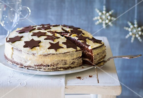 A Christmas cake made with mulled wine and gingerbread spice and decorated with chocolate stars