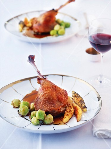 Goose confit with a trio of potato orzo pasta and Brussels sprouts