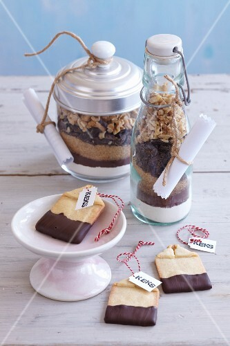 Teabag-shaped biscuits and ingredients layered in jars as presents