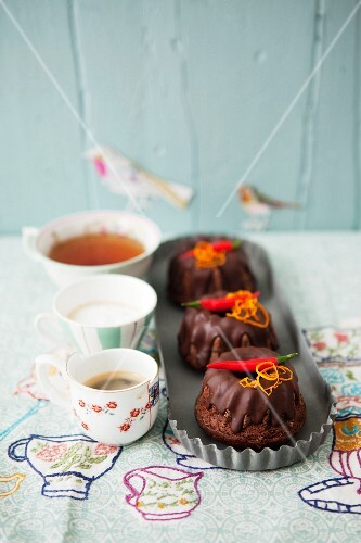 Mini macadamia nut and chilli Bundt cakes served with tea and coffee