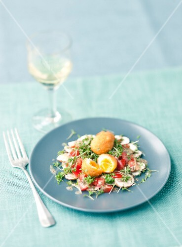 Fried quail's eggs on a mushroom salad with cress