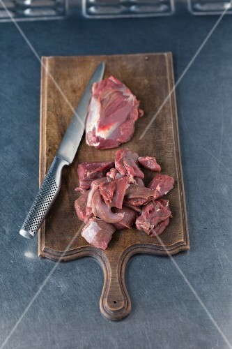 Venison ragout being made: meat being chopped