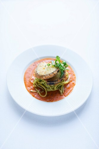 Aubergine piccata on a bed of green linguine
