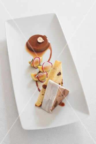 A composition of appetisers with goose liver terrine