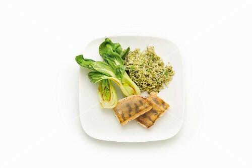Zander with green vegetable rice, bok choy and moringa powder