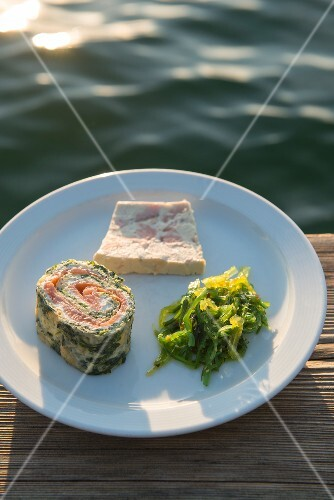 Gourmet fish terrine and pancake rolls filled with salmon