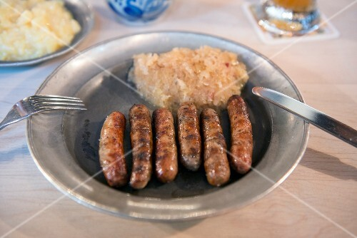 Grilled bratwurst sausages with sauerkraut